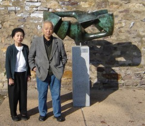 Hiroko and Masami Kodama pose in front of one of his pieces at the Michener Museum in Doylestown, PA